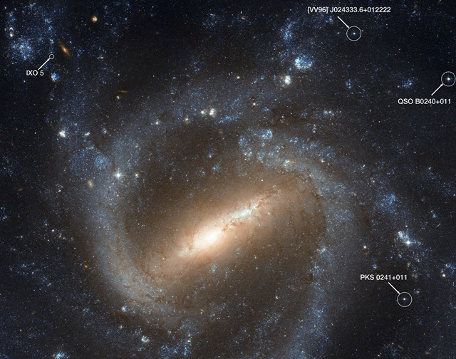 Labelled Hubble image of NGC 1073, showing quasars and IXO 5
