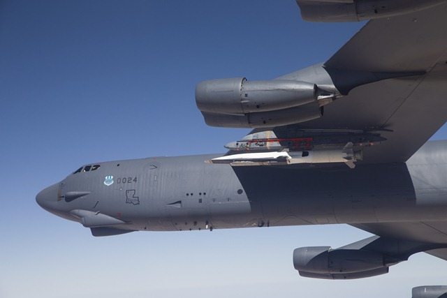 B-52 carries the X-51 Hypersonic Vehicle out to the range for launch test. May 1, 2013. Photographer: Bobbi Zapka