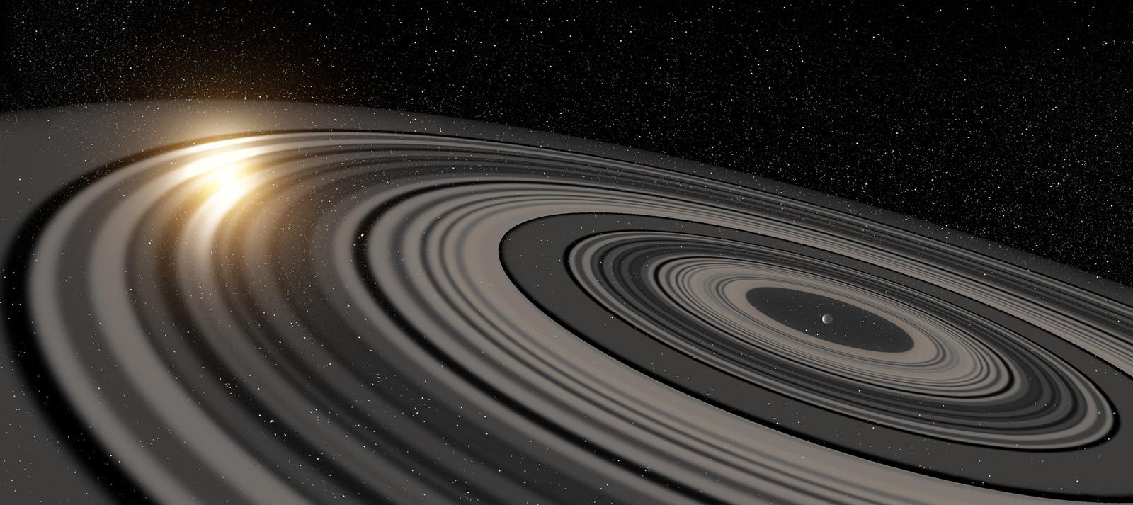 Des ombres amènent à modéliser un système d'anneaux largement plus grand que celui de Saturne